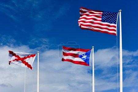 Flags atop El Morro Fortress Puerto Rico