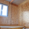 Construction of wood frame walls of a country hous...