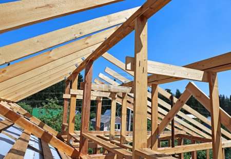 Installation of wooden beams at construction the r...