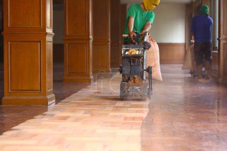 Carpenter was polishing wood floors.