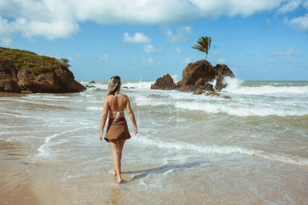 Woman in Tambaba Beach in Brazil, known for allowing the practice of nudism / naturism