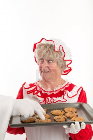 Santa's hand reaching in to grab a cookie