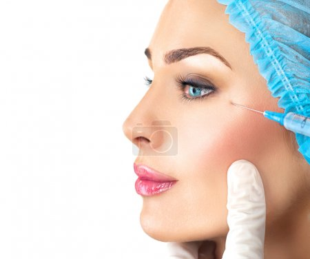 Beauty woman gets facial injections.