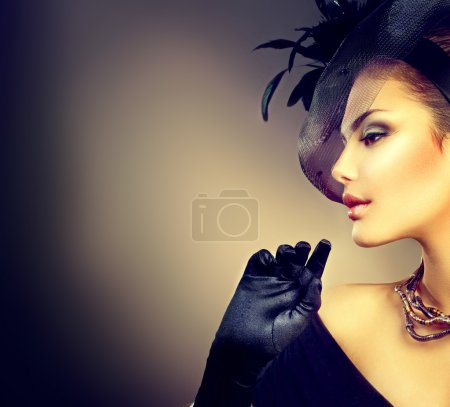 girl wearing hat and gloves