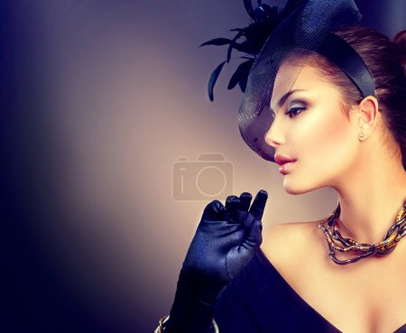girl wearing hat and gloves.