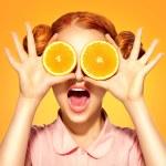 Beauty model girl takes juicy oranges...