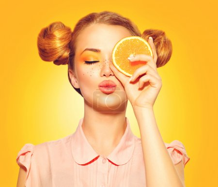 model girl takes juicy orange