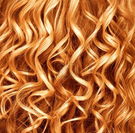 Curly ginger hair closeup.