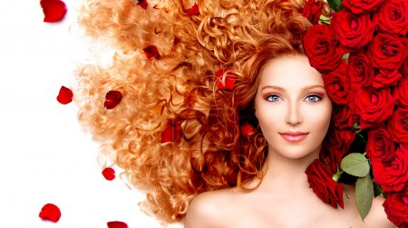 Photo for Beauty model girl with curly red hair and beautiful red roses - Royalty Free Image