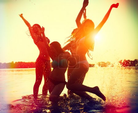 Teenage girls having fun in water