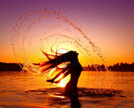 Photo for Beauty model girl splashing water with her hair - Royalty Free Image