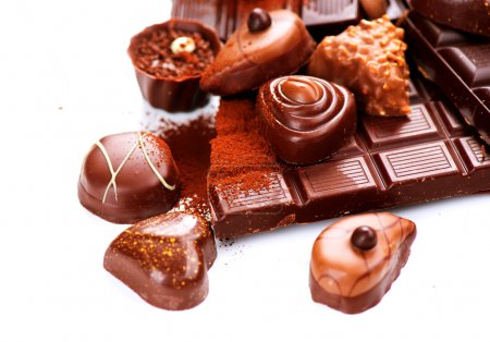 Photo for Chocolates border isolated on white background. Chocolate - Royalty Free Image