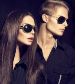 Fashion models couple wearing sunglasses