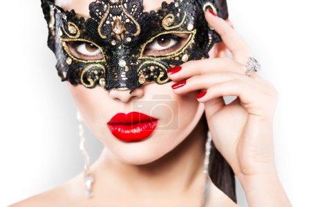 woman wearing masquerade carnival mask