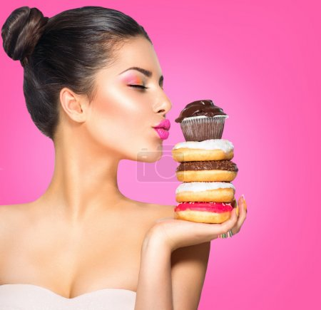 Photo for Beauty fashion model girl taking sweets and colorful donuts - Royalty Free Image