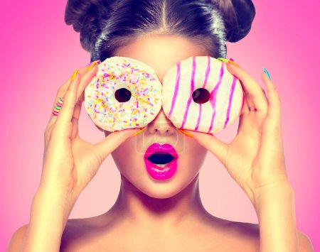model girl taking colorful donuts.