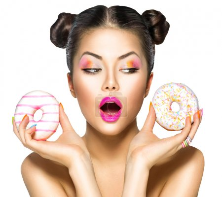 girl taking colorful donuts.