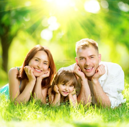 Photo for Happy joyful young family having fun in summer park - Royalty Free Image