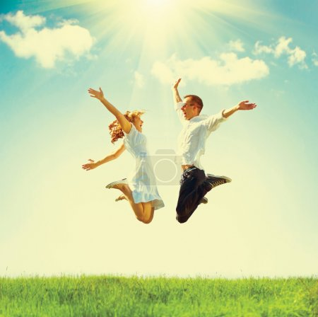 Jumping family on green field