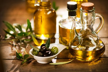 Bottles of olive oil with olives