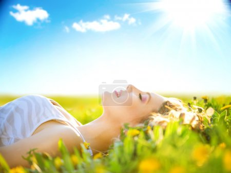 Photo for Beautiful healthy girl lying on summer field with flowers - Royalty Free Image