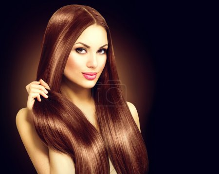 woman touching her  straight hair