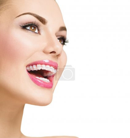 woman smiling with braces on teeth