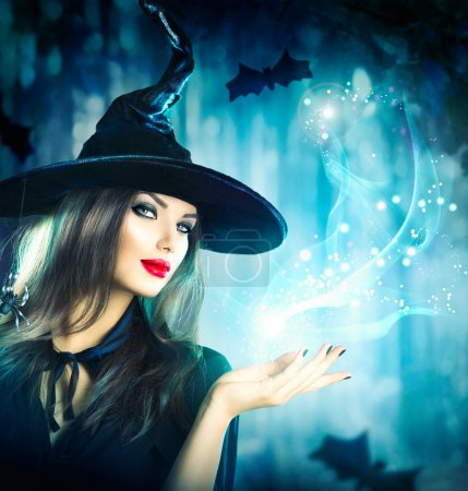 Halloween Witch holding magical light in her hand...