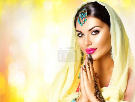 Indian girl with mehndi tattoos