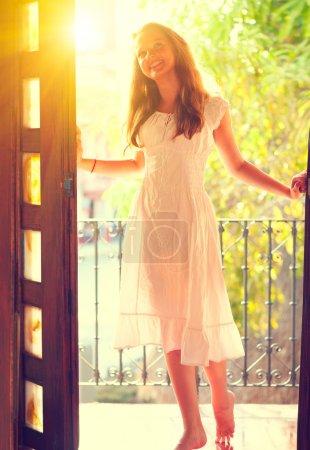 girl standing on the balcony