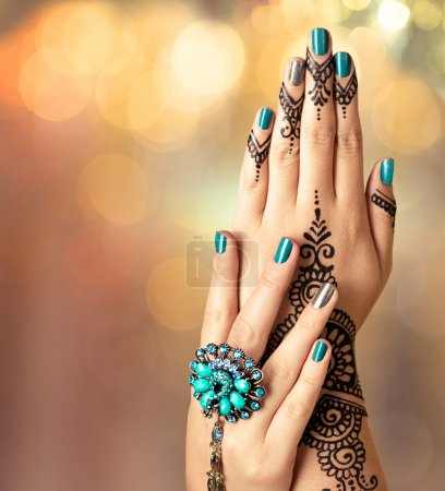 Woman hands with  henna tattoo