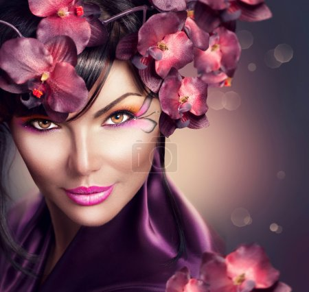 Photo for Beautiful woman with orchid flower hairstyle and creative makeup - Royalty Free Image