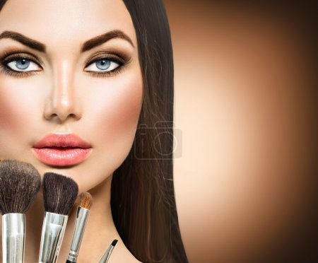 girl with makeup brushes