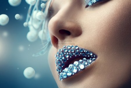 Holiday makeup with gems on lips