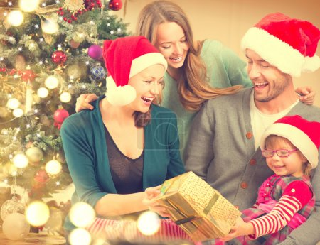 Photo for Happy smiling family at home celebrating Christmas - Royalty Free Image