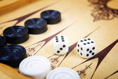 Game field in a backgammon with cubes and counters.