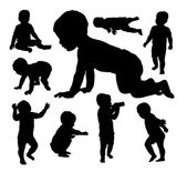 Baby playing silhouettes
