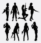 Woman sexy pose with gun silhouette