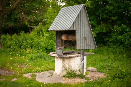 Rural water well with a bucket. Ukraine.