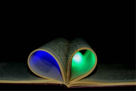 Open book on the table with lighting...
