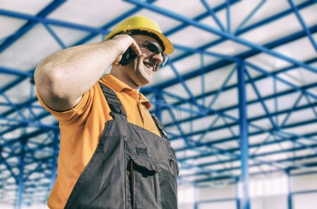 Worker in protective uniform in production hall