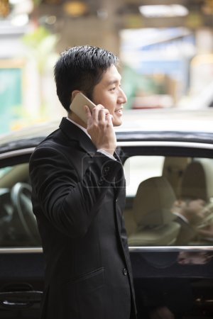 Chinese businessman using his cellphone