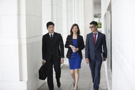 Chinese Business colleagues walking