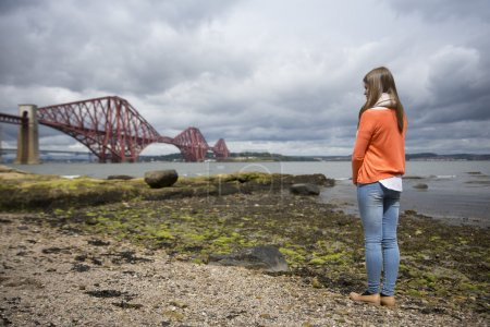 woman in view of The Forth Bridge