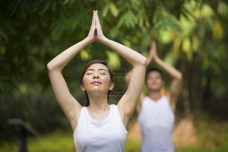 Asian Man and woman doing Tai Chi