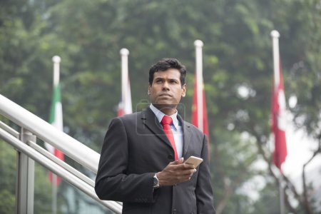 Indian businessman with looking away