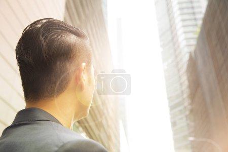 Asian businessman looking away