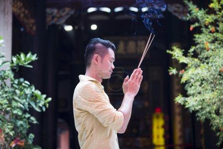 Chinese man is praying