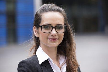 Businesswoman standing in urban setting