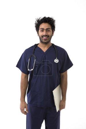 Indian doctor wearing dark blue Scrubs